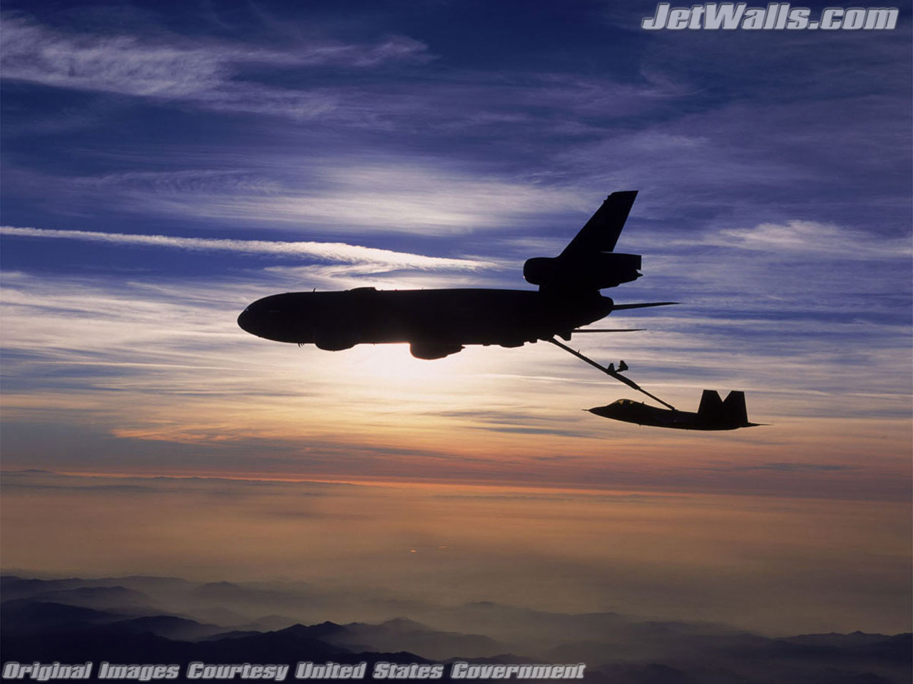 """KC-10 Extender refuels an F/A-22 Raptor"" - Wallpaper No. 63 of 101. Right click for saving options."
